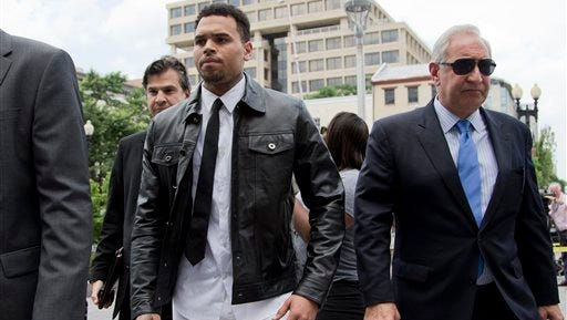 Singer Chris Brown arrives at the D.C. Superior Court, in Washington today. Brown arrived for a hearing on the assault charge he faces.  Brown was arrested and charged with misdemeanor assault in October, accused of hitting a man outside the W hotel. That man says Brown hit him after he tried to get in a photograph that the singer was taking with two women.