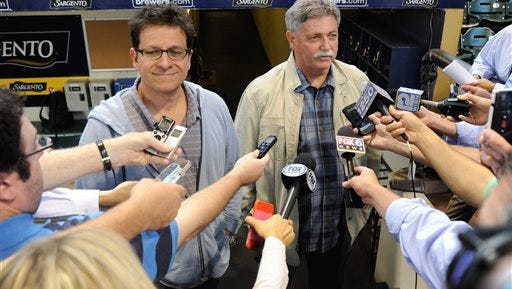 Milwaukee Brewers GM Doug Melvin (right) and owner Mark Attanasio speak to the media before a baseball game against the Chicago Cubs Saturday, Sept. 27, 2014, in Milwaukee. (AP Photo/Benny Sieu)