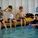 Fox Petzold (left), 4, Liam Prey, 5, and Jason Jenkins, 4, take part in a class at the newly opened Swim School in Bossier City. From left, Fox Petzold, 4, Liam Prey, 5, and Jason Jenkins, 4, take part in a class at the newly-opened Swim School in Bossier City.Val Horvath Davidson/The Times