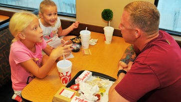 Jeff Brawner has breakfast with his daughters, Mackenzie and Aullie, at Chick-fil-A in Viera