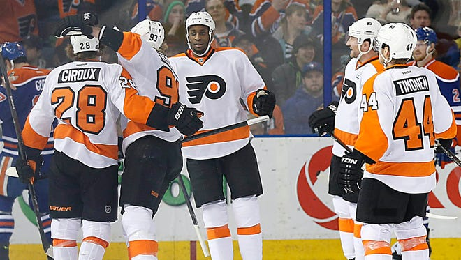 The Philadelphia Flyers celebrates forward Wayne Simmons (17) second period goal against the Edmonton Oilers at Rexall Place.