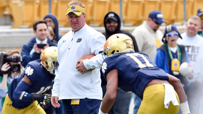 Apr 22, 2017; Notre Dame, IN, USA; Notre Dame Fighting Irish Defensive Coordinator Mike Elko participates in warmups before the Blue-Gold Game at Notre Dame Stadium. Mandatory Credit: Matt Cashore-USA TODAY Sports