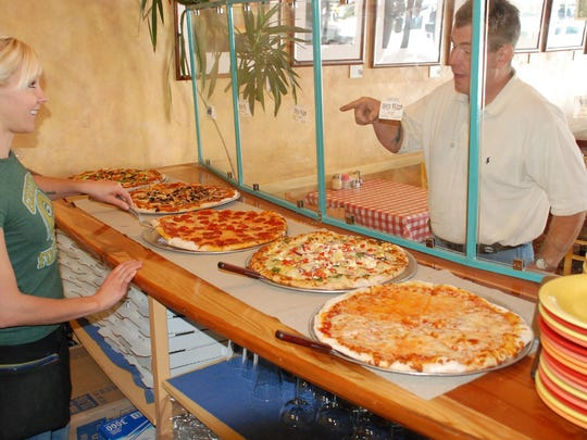 Customers can order by the slice at Bill's Pizza in