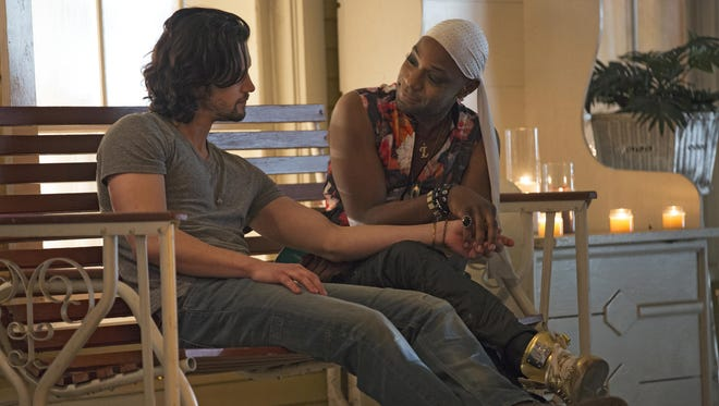 "Nathan Parsons, Nelsan Ellis in a scene from season 7, episode 5 of ""True Blood."""