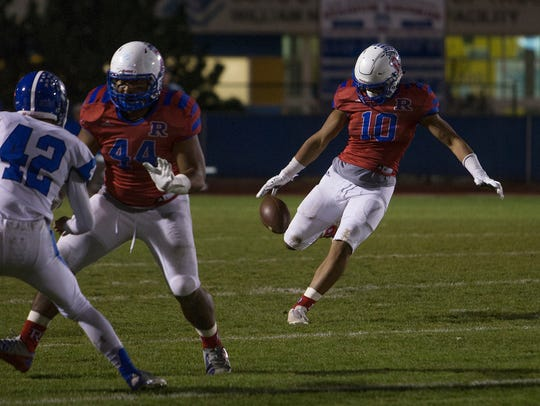 Reno's Brandon Kaho punts against Carson in their playoff