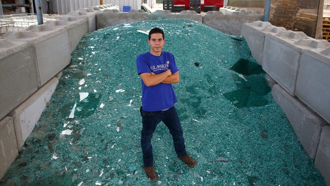 Blake King stands atop some of the raw glass that the company turns into usable product for distribution at GlassKing Recovery and Recycling in Phoenix on June 15, 2018.