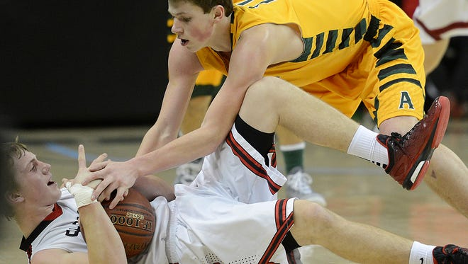 Shawano's Adam Bartz (24) calls for a timeout after picking up a loose ball against Ashwaubenon's Kyle Monroe (11) in Tuesday night's game during the Sun Drop Shootout at the Kress Events Center. Evan Siegle/Press-Gazette Media