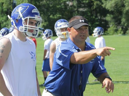 New head coach Mike Oliva works with his football squad during the first day of practice at Pearl River High School Aug. 18, 2014 .