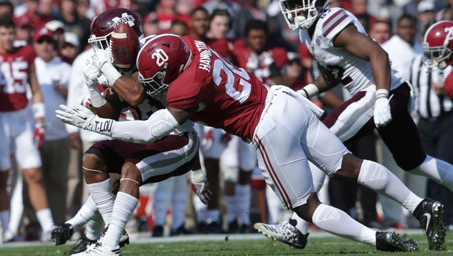 Mississippi State wide receiver Keith Mixon is hit by Alabama linebacker Shaun Dion Hamilton at Bryant-Denny Stadium.
