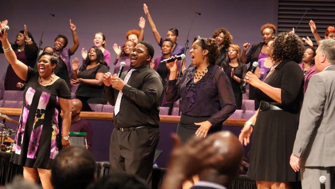 Much of the congregation and choir dressed in purple for cancer awareness at Mt. Zion Baptist Church's service on Sunday.