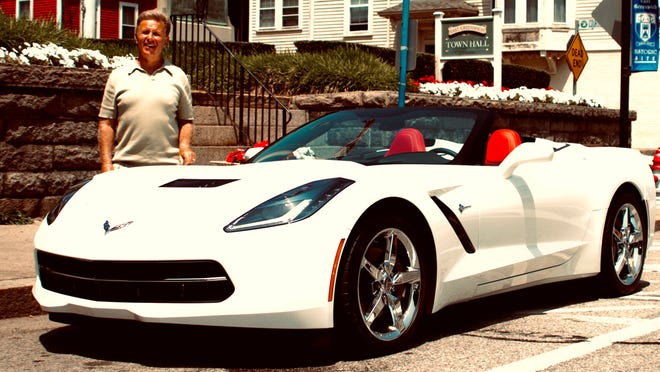 Bob Masse, a professor at Bryant University in Smithfield, Rhode Island, is shown here a few years ago with his white Corvette Stingray. Masse has a brand-new mid-engine 2020 Corvette on the way and expects delivery in March.
