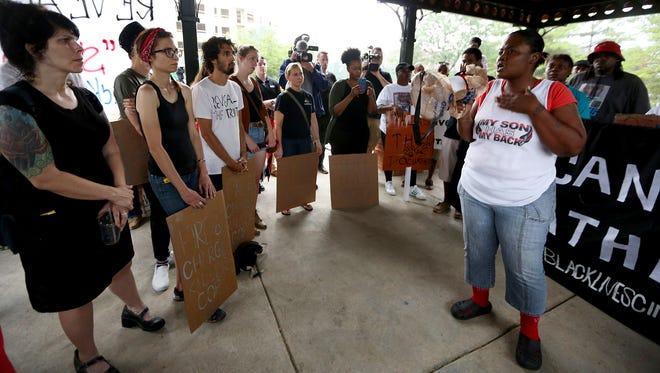 """Erica Woods, mother of QuanDavier Hicks, 22, who was shot and killed by Cincinnati Police on June 9 speaks during the Black Lives Matter: Cincinnati's """"Reveal the Truth and SAY NO MO'!"""" rally in Northside Thursday."""