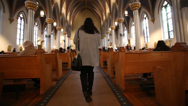 Parishioners arrive for Easter Sunday at the Most Holy Trinity church in Detroit on March 27, 2016.
