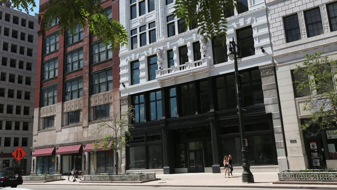 Storefronts sit empty on Woodward Avenue in downtown Detroit on Friday, May 27, 2016