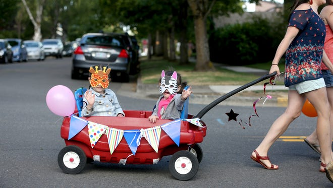 The children's parade opens the Salem Art Fair on Friday, July 15, 2016.