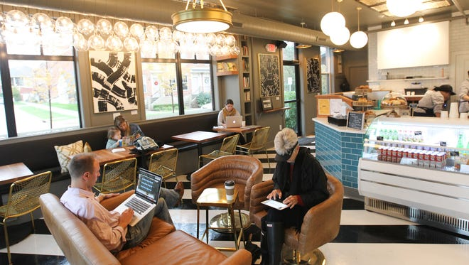 Patrons enjoy a quiet morning at The Dingo Bar in the Peninsula Neighborhood on Wednesday, Oct. 26, 2016.
