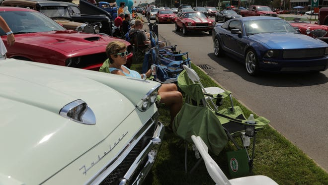 Classic and custom cars inch their way from Ferndale to Pontiac during the  Woodward Dream Cruise.