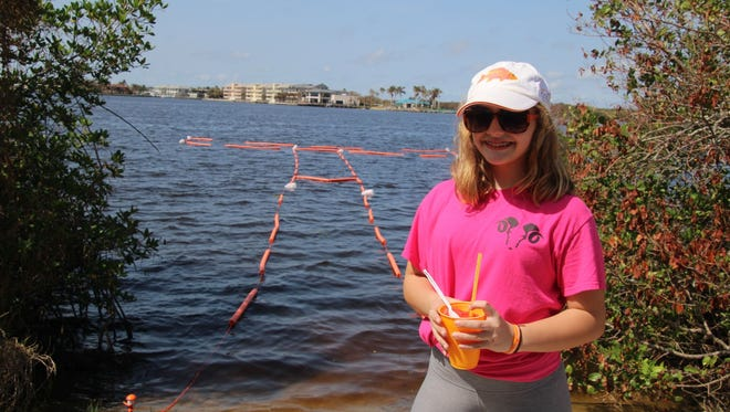 MaryGrace Coppola in front of the floating outline of the future site of the Cole Coppola Memorial Fishing Pier on the Indian River Lagoon.