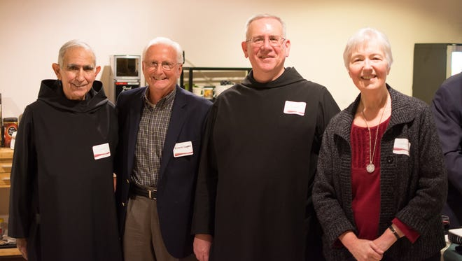 Prior Vincient, Richard Hagedorn, Fr. Philip, and Sr. Dorothy Jean at a transfer ceremony Dec. 6 marking Queen of Angels Monastery, the Benedictine Sisters of Mt. Angel and Catholic Community Services joining forces to sustain St. Joseph Shelter.