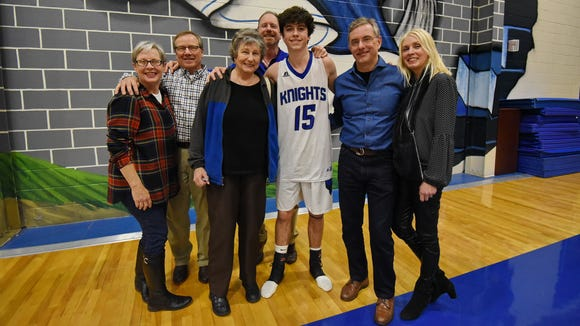 St. Joseph's senior Emilio Trocha (15) is surrounded by, from left, friends Irene and David Sartori; his grandmother, Martha Trocha; his father, Steve Trocha; and friends Philip and Sherry Isherwood following the Knights' win Tuesday night.