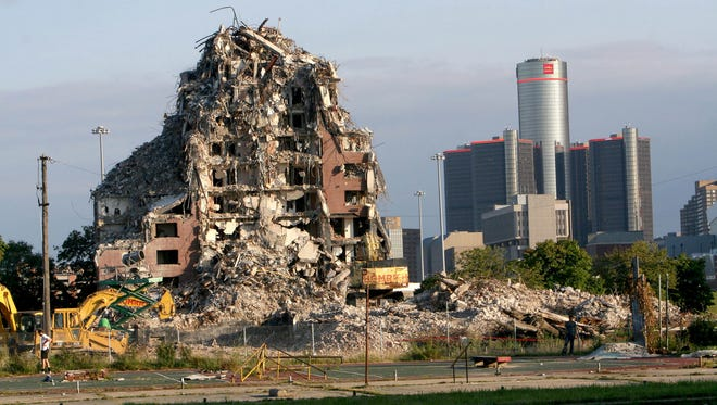 Tearing down one of the towers of the Brewster-Douglass Housing Projects located in the Brush Park section of Detroit in September 2014.