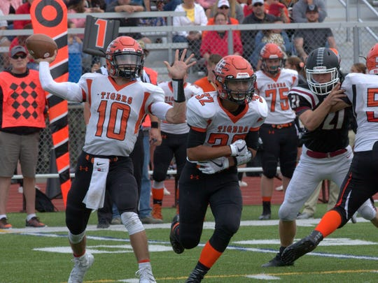 Devon Hogan passes the ball for Union-Endicott on Saturday during the Tigers' 36-15 win over Elmira at Ernie Davis Academy.