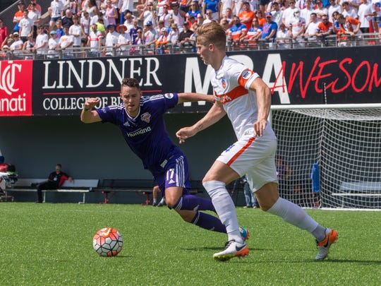 FC Cincinnati's Harrison Delbridge and Louisville City FC's Chandler Hoffman fight for the ball in the first half of the game at Nippert Stadium Saturday July 23, 2016. FC Cincinnati won 2-0.