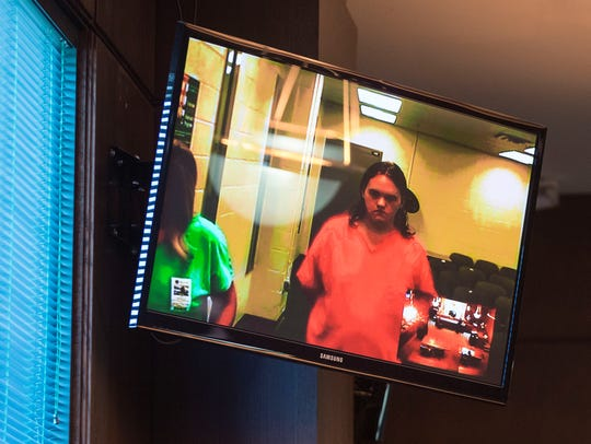 Austin Hunter made an appearance via a video call during his arraignment in a Collier County courtroom Saturday, Nov. 18, 2017.