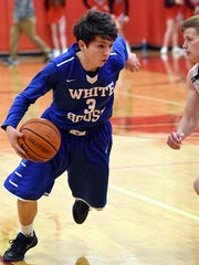 White House High freshman guard Cole Pond dribbles