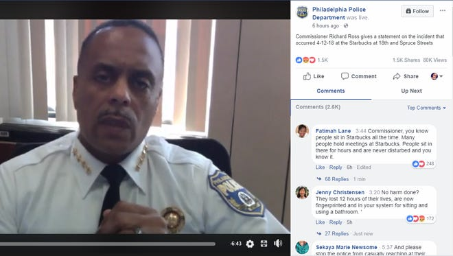 A screenshot of the Philadelphia Police Department Facebook page shows Commissioner Richard Ross speaking during a Facebook on the incident of two men arrested at a local Starbucks.