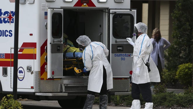 A patient is transported by ambulance from the Freedom Square Seminole Nursing Pavilion on Friday, April 17, 2020 in Seminole, Fla. About 30 patients and staff members at a Pinellas County nursing home have tested positive for the coronavirus, county officials said.