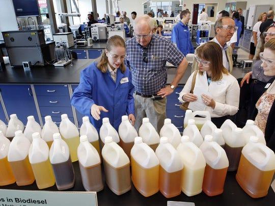 Biochemical engineer Shannon Sanford shows off bottles
