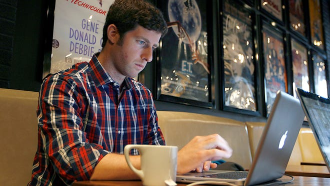 Rabbi Dan Horwitz, 32, of Huntington Woods works on his laptop at the Maple Theater Kitchen in Bloomfield on Friday, Sept. 30, 2016.  Named by the Forward as one of America's most inspiring rabbis, he leads The Well.