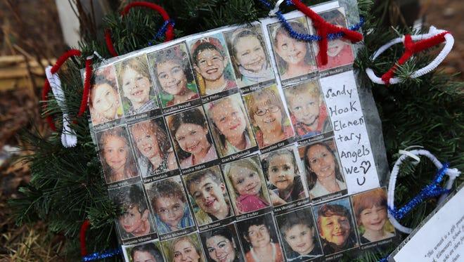 Photos of Sandy Hook Elementary School massacre victims in Newtown, Conn.