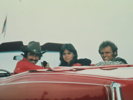 Burt Reynolds, Sally Field and Jerry Reed in a scene