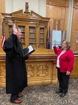 Ionia County Probate Judge Robert Sykes Jr. (left) administers the oath of office to new Ionia County Register of Deeds Rhonda Lake during a ceremony Dec. 29 in the Ionia County Eighth Circuit Courtroom.