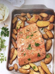 Roast salmon with potatoes and mustard-herb butter makes a light and flavorful springtime dinner.