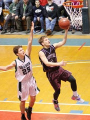 Proctor's Nick Swane goes to the hoop in front of Sharon's