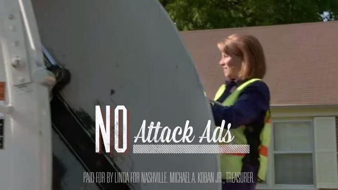Mayoral candidate Linda Eskind Rebrovick rides on the back of a garbage truck and picks up used television sets from across Nashville in a new television ad.