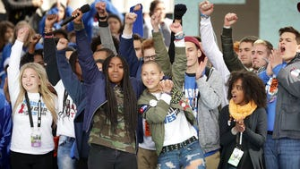 Students from Marjory Stoneman Douglas High School, including Emma Gonzalez, center, stand together on stage with other young victims of gun violence at the conclusion of the March for Our Lives rally on March 24, 2018 in Washington, DC.