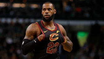 Cleveland Cavaliers forward LeBron James looks on from the court against the Boston Celtics in the first quarter at TD Garden.
