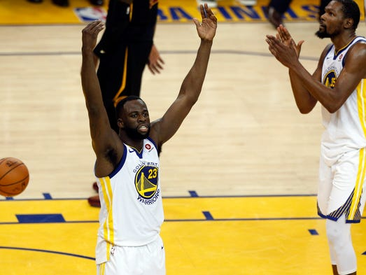 e14e28fe1998 May 31  Draymond Green and Kevin Durant react during