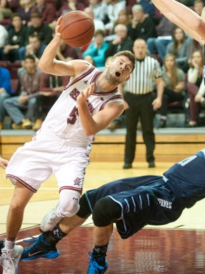 Northwood forward Zach Allread gets his feet tangled with driving Bellarmine Knights guard Rusty Troutman. 13 November 2015