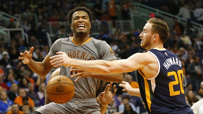 Phoenix Suns forward TJ Warren (12) is fouled by Utah Jazz forward Gordon Hayward (20) during the third quarter at Talking Stick Resort Arena in Phoenix January 16, 2017.
