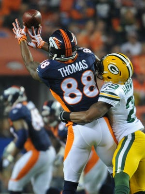 Green Bay Packers cornerback Casey Hayward (29) breaks up a pass to Denver Broncos wide receiver Demaryius Thomas (88) against the Denver Broncos at Sports Authority Field November 1, 2015.