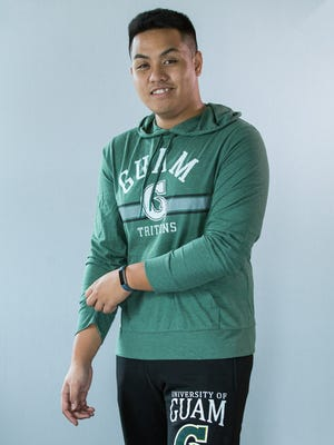 Julian Briosos models some of the merchandise available at UOG's new online store.