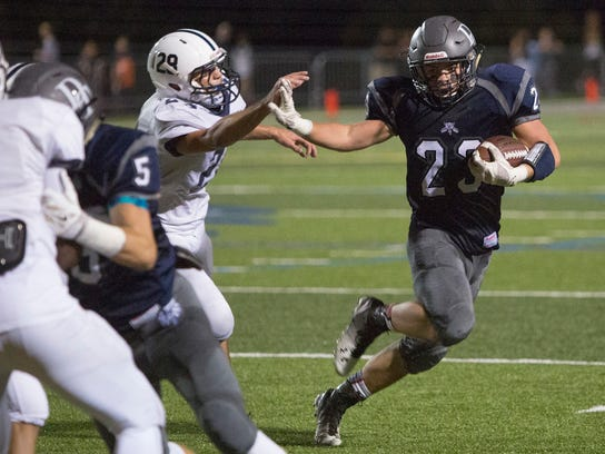 West York's Ryan Narber pursues Dallastown's Dillon Callahan during the second half. Dallastown Area High School defeats West York Area High School 10-0 in Dallastown, Friday, September 11, 2015. Paul Chaplin  - For GametimePA.com