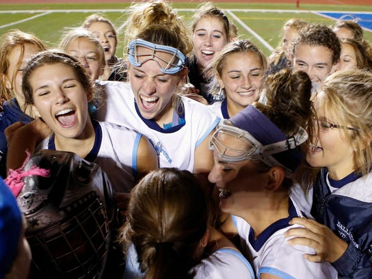 Dallastown players come together after beating Red Lion on penalty strokes Thursday night to win the YAIAA field hockey tournament title at Spring Grove. (For the Daily Record/Sunday News -- Shane Keller)