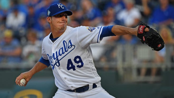 Kansas City Royals pitcher Heath Fillmyer (49) delivers a pitch during the first inning against the Detroit Tigers at Kauffman Stadium. Mandatory Credit: Peter G. Aiken/USA TODAY Sports
