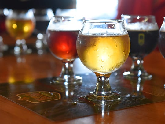 Flights of beer are available for yoga class members